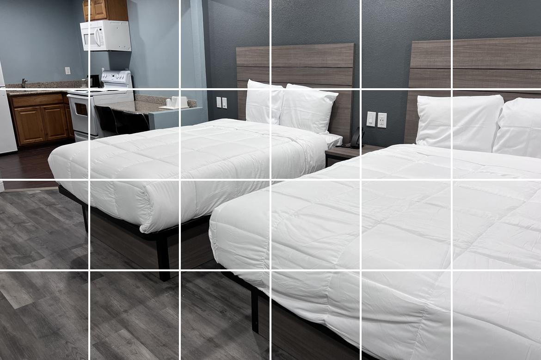 QUEEN BED ROOM AT THE Surf City Inn & Suites Santacruz HOTEL
